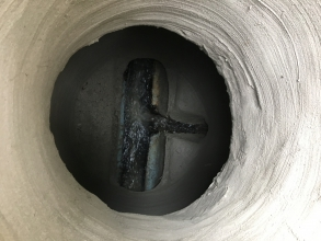 After photo from using a spray application of geopolymer mortar to rehabilitate of a utility hole.